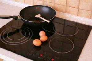 Black smooth top cooking range.