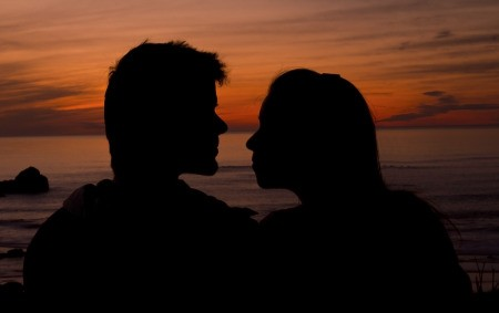 Shadows of a couple in love in front of the Sunset over the Pacific Ocean