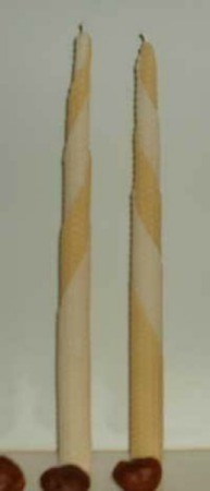 Beeswax candles in a tapered shape.