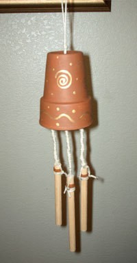Wind chimes that are made from a clay pot.