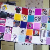 A quilt made of pictures of different famous women.