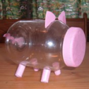 A pink piggy bank made from a plastic mayo bottle.