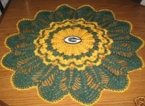 A doily in yellow and green with a G for Green Bay Packers.