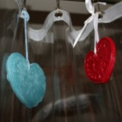 Recycled Candle Wax Air Freshener - Air fresheners hanging from shower curtain rings.