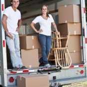 A couple loading a moving truck.