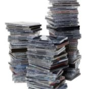 Three large stacks of CD Jewel Cases.