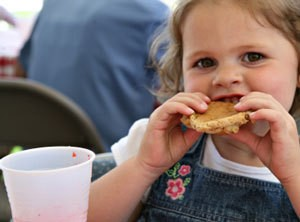 A girl eating a cookie.