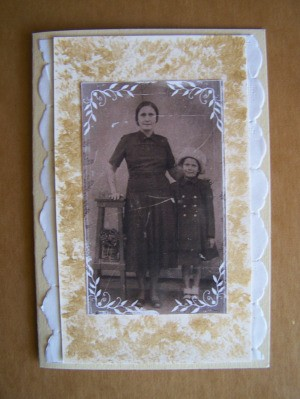 Photo glued to front of card.