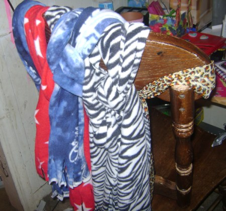 Storing Winter Scarves on a chair.