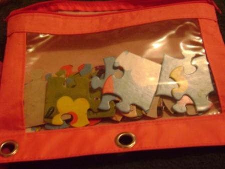 Pencil bag holding puzzle pieces