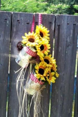 Tin can flower holder for wedding.
