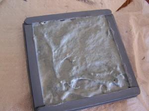 Plaster added inside frame.