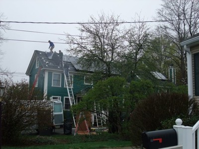 Solar Panels being installed on a house.