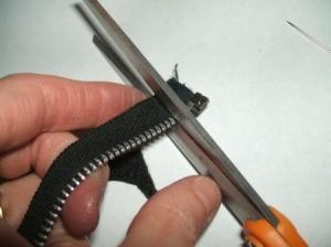 Cutting stop off of zipper.