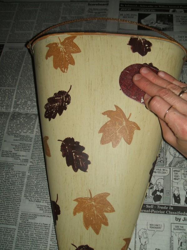 Sanding original bucket finish.