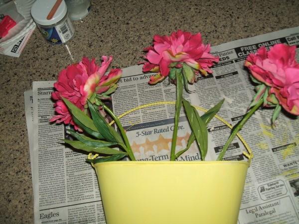 Adding tall flowers first.