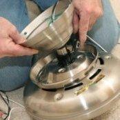 Repairing a ceiling fan.