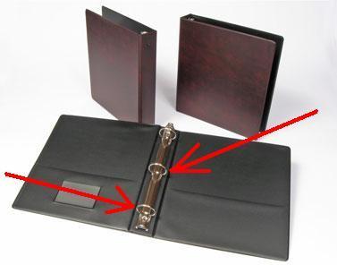 Three ring notebook binder.