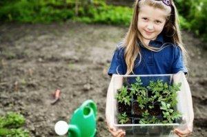 Girl Holding Seedlings