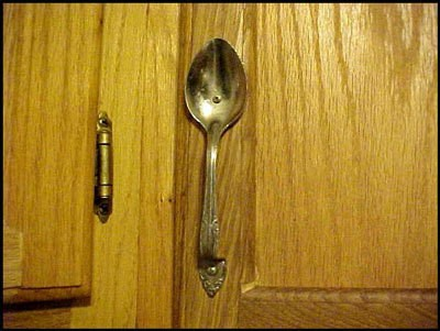 A Cabinet With A Spoon As Hardware.