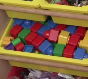 toys organized in plastic bins