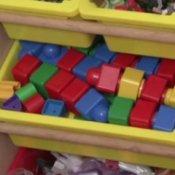 toys organized in plastic bins