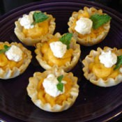 A plate of mini pumpkin tarts.