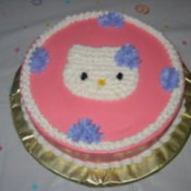 A cake decorated with Hello Kitty.