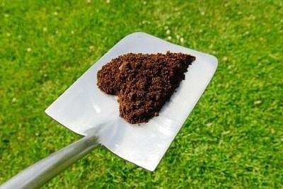 heart shaped mulch on shovel