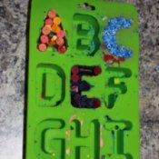 Making recycled letter crayons.