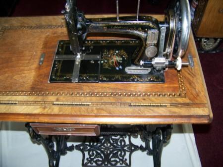 Antique sewing machine open.