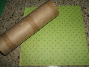 First piece of scrapbook paper and tube.