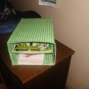 Cereal box storage covered with green and white fabric