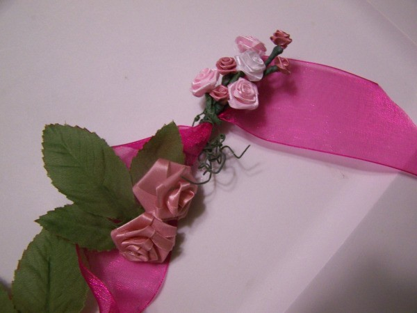 Floral Fan Pin - silk roses being attached to ribbon.
