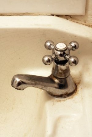 Removing rust stains from a sink.