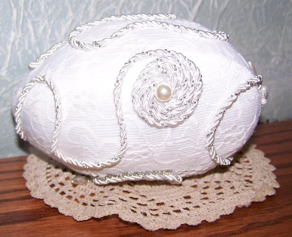 White egg with cording decoration.