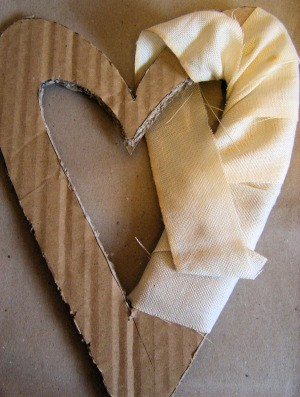 Wrapping fabric on cardboard form.