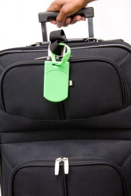 Generic black suitcase with bright green tag.