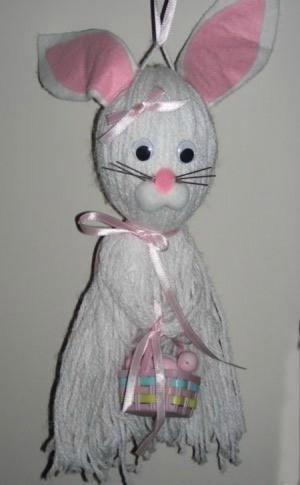 Hanging white yarn bunny.