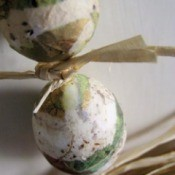 Decoupaged Easter eggs made from strips of paper.