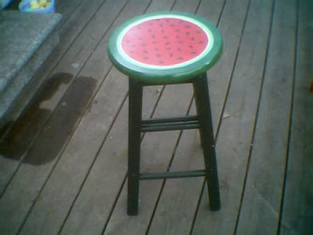 Cool stool painted to look like a watermelon.