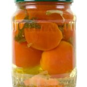 Jar of pickled tomatoes.