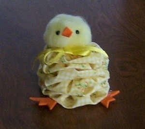 A cute chick made from fabric yo-yos.