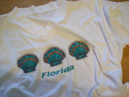 T-shirt with shells on it.