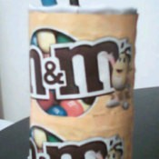 Recycle Cans and Packaging Into Storage Containers - decorated with M & M wrappers.