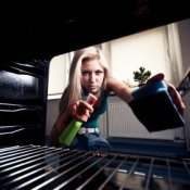 Keeping Your Oven Clean, Young Woman Cleaning her Oven