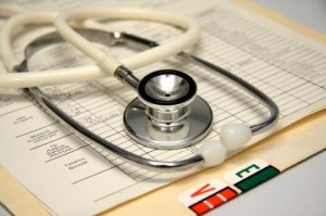 Keeping Track Of Medical Information, Stethoscope on a Medical Chart.