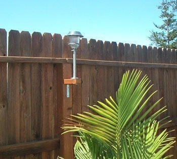 Attach Solar Lights to Your Fence - Solar light attached to a fence post.