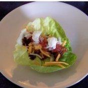 Taco filling on lettuce leaf.