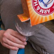 Pouring Baking Soda for Balloon Experiment